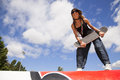 Cool skateboard woman at a public graffiti park Royalty Free Stock Images