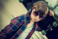 Cool skater looking boy with sunglasses and headphone vintage effect added Stock Images