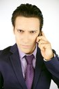 Cool strong business man on the phone angry in suit Royalty Free Stock Image