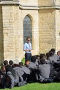 Cool teacher giving lecture in grounds of Cathedral