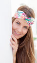 Cool trendy girl with a flowered hair scarf smiling Royalty Free Stock Photo