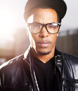Cool urban african american man close up photo of a with glasses Stock Photo