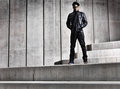Cool urban african american man on distopic concrete steps Royalty Free Stock Photo