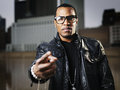 Cool urban guy with glasses african american making hand sign Royalty Free Stock Photo