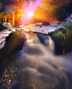 Cool waterfall in wild forest creatively lit beautifully at night Royalty Free Stock Images