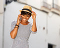 Cool young african american woman listening to cell phone Royalty Free Stock Photo