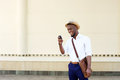 Cool young black man looking at mobile phone Royalty Free Stock Photo
