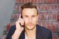 Cool young business man talking on mobile phone Royalty Free Stock Photo