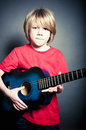 Cool young male model with an accoustic guitar retro studio shot of a holding old Stock Photos