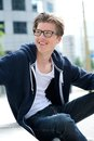 Cool young man with glasses smiling Royalty Free Stock Photo