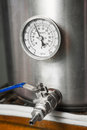 Cooling a home brew beer wort stock pot in kitchen while Royalty Free Stock Image