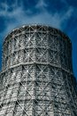 Cooling tower of nuclear power plant against blue sky, close up Royalty Free Stock Photo