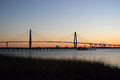 Cooper river bridge sunset sun setting over the near charleston south carolina Royalty Free Stock Photos