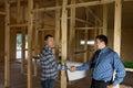 Coordenador e arquiteto agreed building design Imagem de Stock