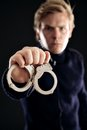 Cop with Handcuffs for Law Offenders Stock Photography