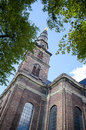 Copenhagen, Denmark - August 25, 2014 - Church tower of Our Saviour (Danish:Vor Frelsers Kirke) baroque church in Copenhagen, Denm Royalty Free Stock Photo