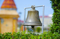 Copper bell on the background of green plants Royalty Free Stock Photos