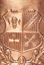 Copper coat of arms background Royalty Free Stock Photo