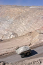 Copper mining trucks carrying ore in the mine chile antofagasta chuquicamata region Stock Images