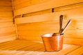 Copper pail and dipper in finnish sauna horizon format Stock Image