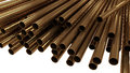 Copper pipes piled in d with clipping path Royalty Free Stock Photography