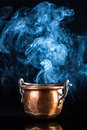 Copper pot and smoke coming out from an old Stock Image