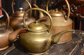 Copper teapot the ancient on a desk Stock Photo