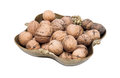 Copper vase with walnuts isolated on a white background Royalty Free Stock Photos
