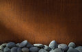 Copper wall border with river rock border Royalty Free Stock Photo