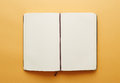Copy space blank notebook on yellow background Stock Image