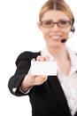 Copy space on her card confident mature customer service representative in headset stretching out hand with business and smiling Stock Photo
