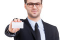 Copy space on his business card cheerful young man in formalwear showing and smiling while standing isolated white Royalty Free Stock Images