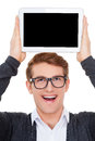 Copy space on his tablet cheerful young man holding a digital upon head and smiling while standing isolated white Stock Photos