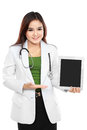 Copy spaced portrait of female doctor holding a tablet with empty screen isolated on white Stock Images
