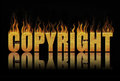 Copyright block of text in flames Royalty Free Stock Photography