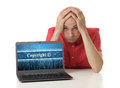 Copyright concept frustrated man with laptop Royalty Free Stock Photo