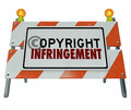 Copyright infringement violation barrier barricade construction words on a road sign illustrating a of intellectual property or Royalty Free Stock Image