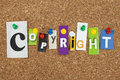 Copyright single letters pinned on cork noticeboard Stock Photo