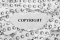 Copyright torn pieces of paper with symbols and the word black and white concept close up Stock Image