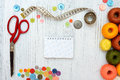 Copyspace frame with sewing tools and accesories on white wooden background Royalty Free Stock Images
