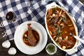 Coq au vin in a oval Dutch oven Royalty Free Stock Photo