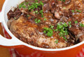 Coq au vin traditional french recipe of chicken casseroled in red wine Stock Images