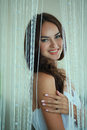 Coquettish girl a beautiful young in the image of the bride with a charming smile Stock Image