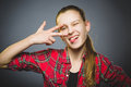 Coquettish girl. Closeup Portrait handsome teen smiling isolated on grey Royalty Free Stock Photo