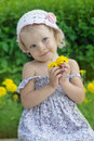 Coquettish little girl portrait with yellow flowers Royalty Free Stock Photo