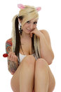 Coquettish young woman with red lollipop and full arm tattoo Royalty Free Stock Photography