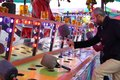 Motion of people playing whack game at the West Coast Amusements Carnival Royalty Free Stock Photo