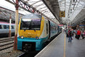 Coradia diesel multiple unit crewe railway station class in arriva trains wales livery waits at platfrom at with a passenger Royalty Free Stock Image