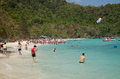 Coral island phuket march people enjoying the surf and sand beach at on march in thailand is a Royalty Free Stock Image