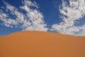 Coral pink sand dune and blue sky with white clouds dunes state park kanab usa Stock Photography